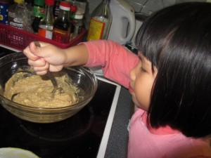 Mixing chocolate chip cookie batter.