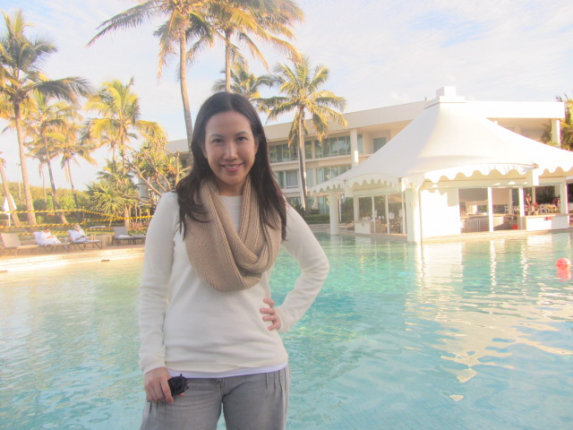 Me by the hotel pool, after our walk along the beach.