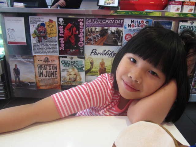 A picture of my daughter at Eros Cafe in West End.