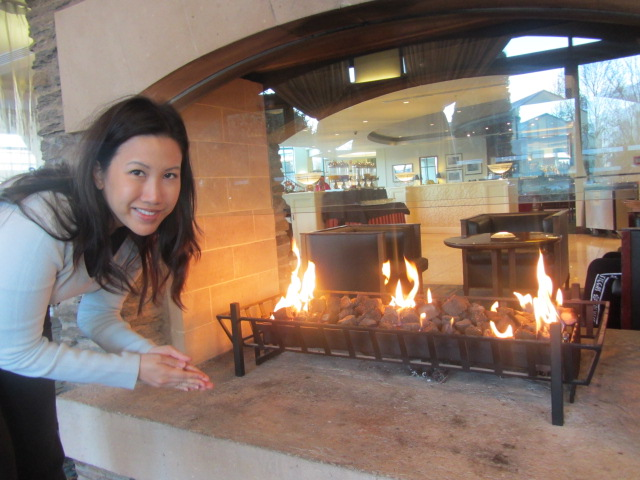 Warming my hands by the fire at the Millennium Hotel, Queenstown, New Zealand.