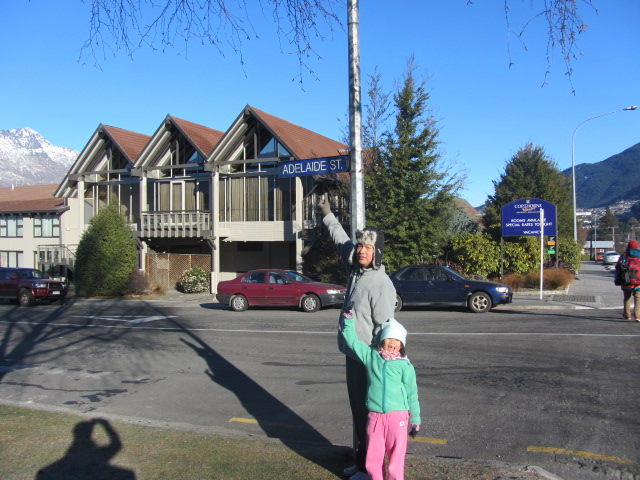A picture of HRH pointing to the Adelaide Street sign outside our next hotel, Copthorne in Queenstown, New Zealand.