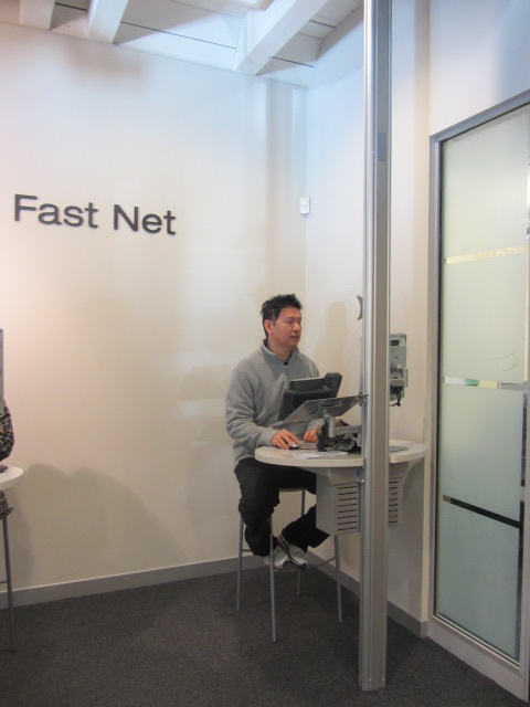 A picture of HRH using a Fast Net kiosk to check his account at ASB Bank in Queenstown, New Zealand.