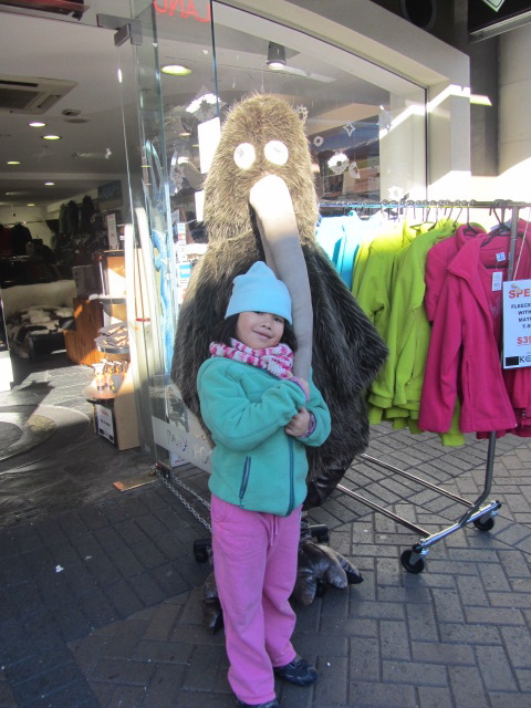 A picture of Amanda with a giant Kiwi outside a gift shop in Queenstown, New Zealand.