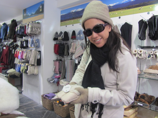 A picture of me with sheep skin booties for my next child in Queenstown, New Zealand.