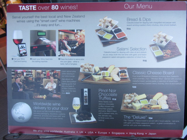 A picture of a board outside the wine-bar we entered in Queenstown, explaining how the system works.