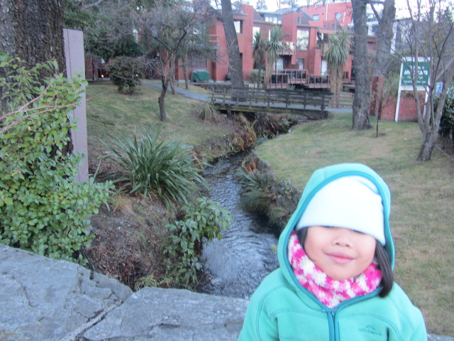 A picture of Amanda outside the St James Apartments in Queenstown, New Zealand.