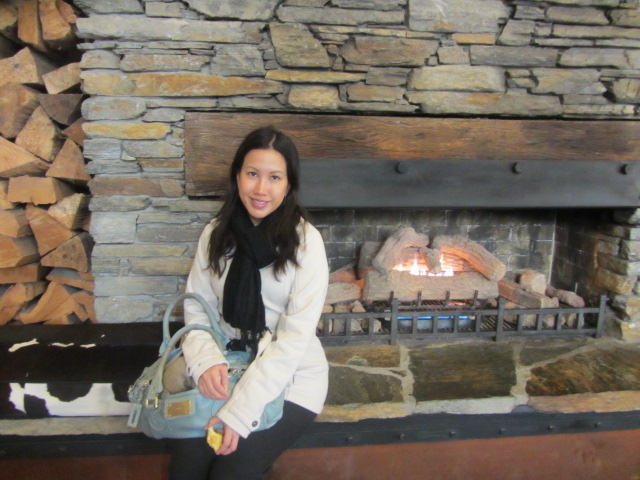 A picture of me by the fireplace at St Moritz in Queenstown, New Zealand.