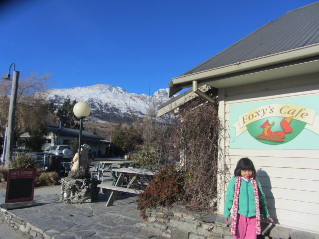 A picture of Amanda outside Foxy's Cafe in Glenorchy, Queenstown, New Zealand.