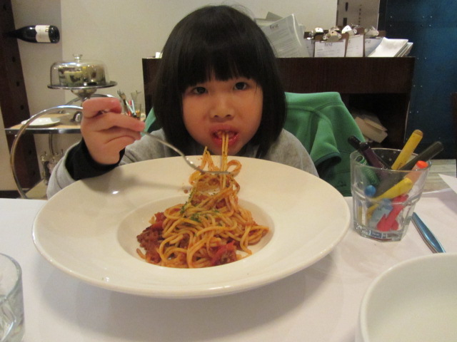 A picture of Amanda eating Spaghetti at FINZ Restaurant in Queenstown, New Zealand.