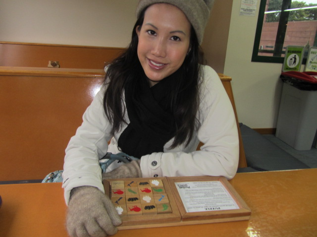 A picture of me and the puzzle I was working on at Puzzling World in Wanaka, New Zealand.