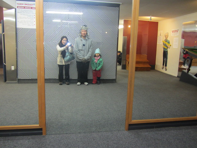 A picture of me, HRH and Amanda at Puzzling World in Wanaka, New Zealand.