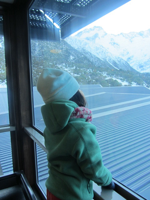A picture of Amanda looking out on the Southern Alps from our hotel balcony on Mt Cook, New Zealand.