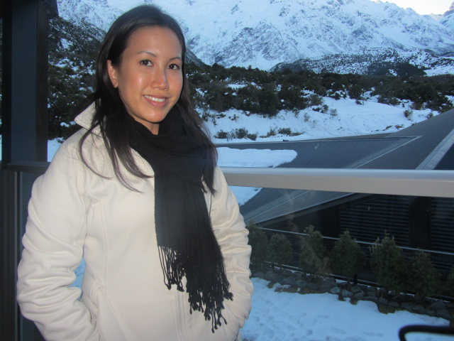 A picture of me on the balcony of our hotel room at The Hermitage on Mt Cook in New Zealand.