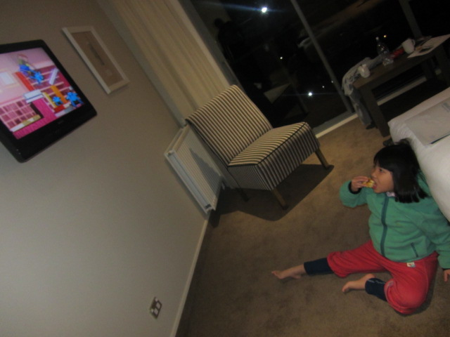 A picture of Amanda watching telly in our hotel room on Mt Cook, New Zeala