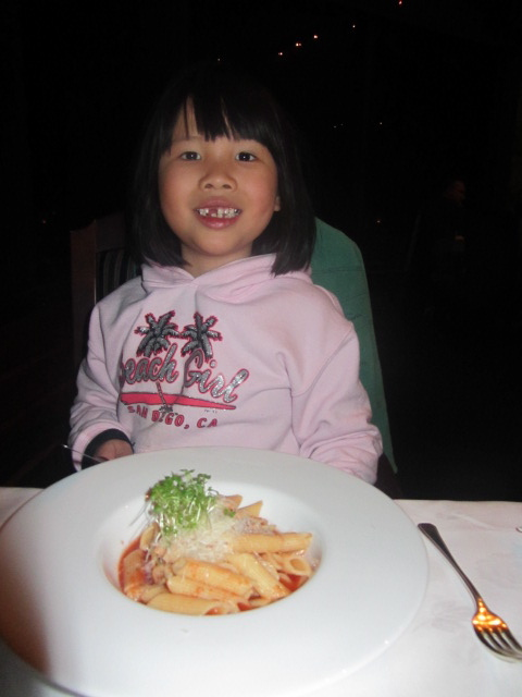 A picture of Amanda and her pasta at the restaurant in The Hermitage on Mt Cook in New Zealand.