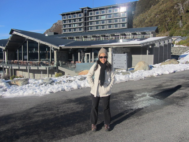 A picture of me with The Hermitage on Mt Cook in New Zealand in the background.