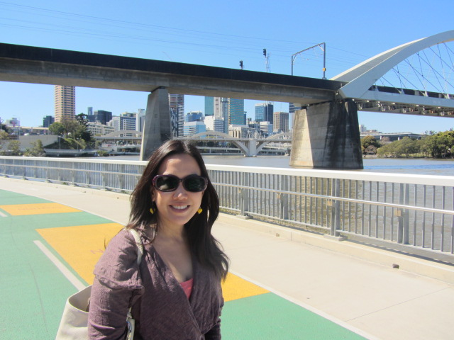 A picture of me one the walkway that links both sides of the Go Between Bridge.