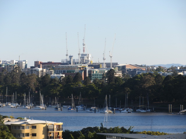 A picture of boats bobbing on the waters from the Story Bridge in Brisbane.