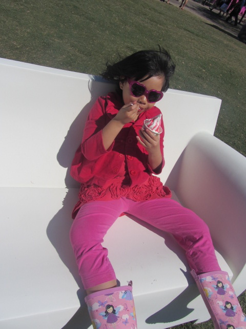 A picture of Amanda enjoying her ice cream cup on a bench at Southbank in Brisbane