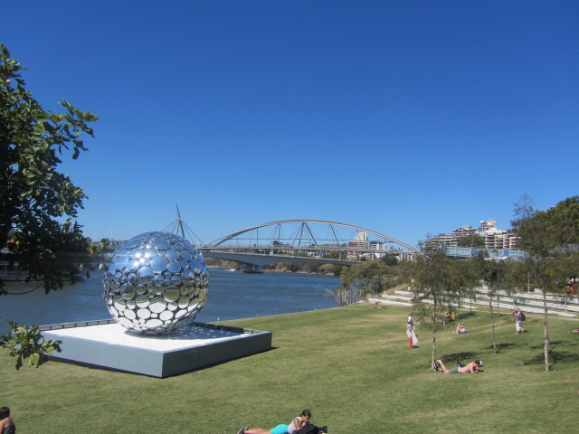 A picture of the Goodwill bridge from afar. The silver ball is a new addition to the parklands.