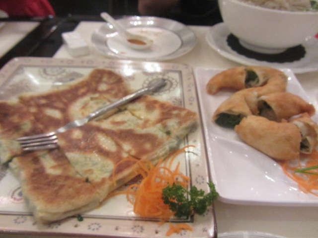 A picture of egg and chives pancakes and shallot twists at Bamboo Basket in Southbank, Brisbane