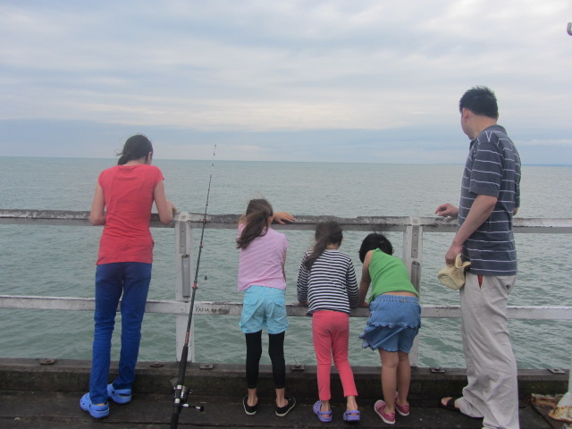 A picture of HRH and the kids at the end of the Urangan Pier in Hervery Bay.