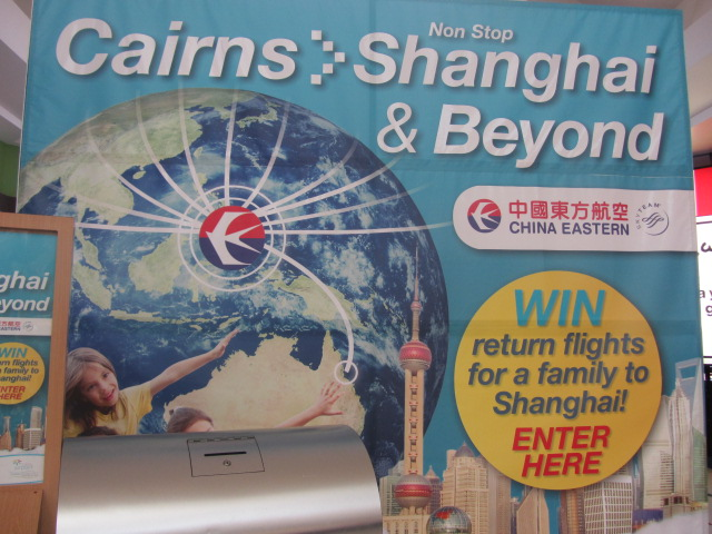 A picture of an advert for flights from Cairns to Shanghai.