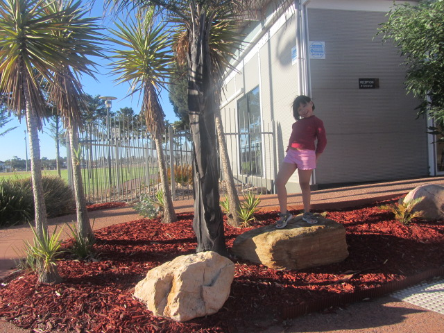 A picture of Amanda posing in front of the Majestic Oasis Hotel in South Australia.