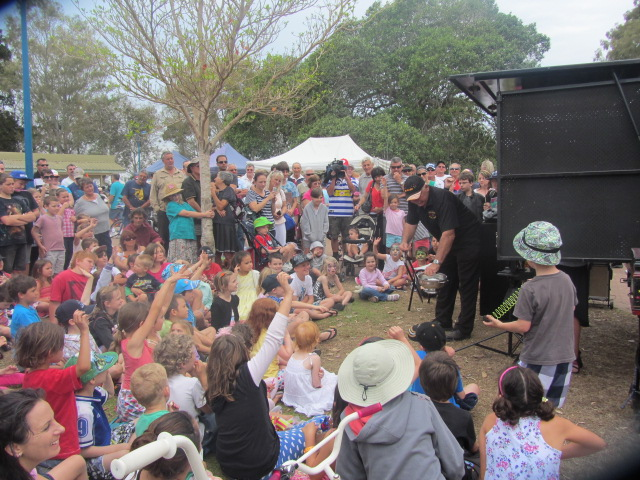 A picture of a stall-holder performing magic tricks at the Urangan Pier in Hervey Bay, Queensland.