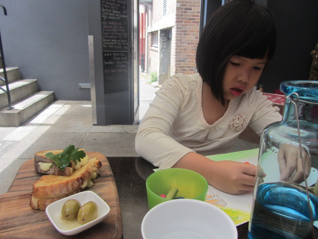 A picture of Amanda colouring at Not Just Coffee in Paddington, Sydney.