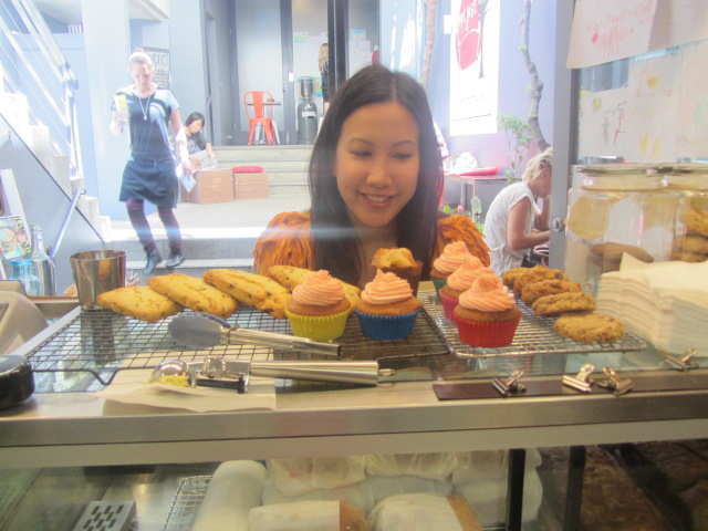 A picture of me salivating over Kit's baked goods at Not Just Coffee, Sydney.